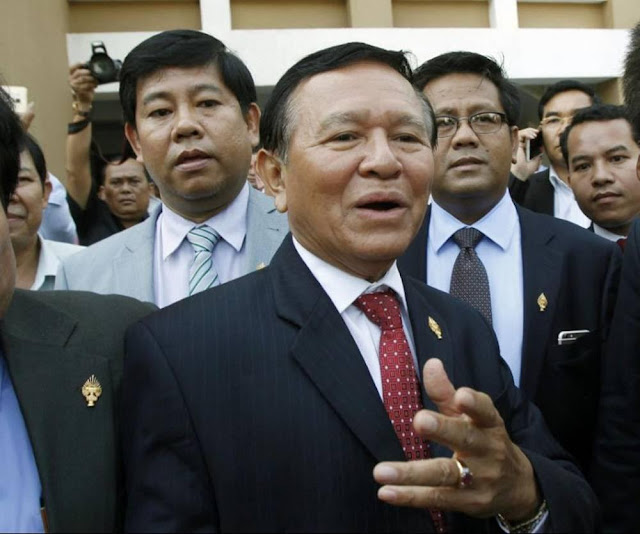 FILE- In this April 8, 2015 file photo, Cambodia's main opposition Cambodia National Rescue Party Deputy President and National Assembly Deputy President Kem Sokha, center, speaks in Phnom Penh, Cambodia. Armed security forces raided the headquarters of Cambodia's main opposition party and intercepted the car of its No. 2 leader Kem Thursday in an apparent attempt to apprehend him, but left empty handed after not finding him in either place, witnesses and officials said. (AP Photo/Heng Sinith, File)