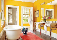 Yellow bathroom with pink rug