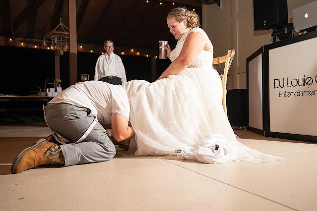 Groom getting garter Magnolia Manor Wedding Photos by Stuart Wedding Photographer Heather Houghton Photography
