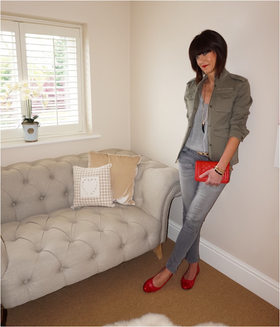 My Midlife Fashion, Hush Military Jacket, Leather Quilted handbag, grey marl t shirt, grey skinny jeans, leopard print belt, red quilted patent tip ballet pumps