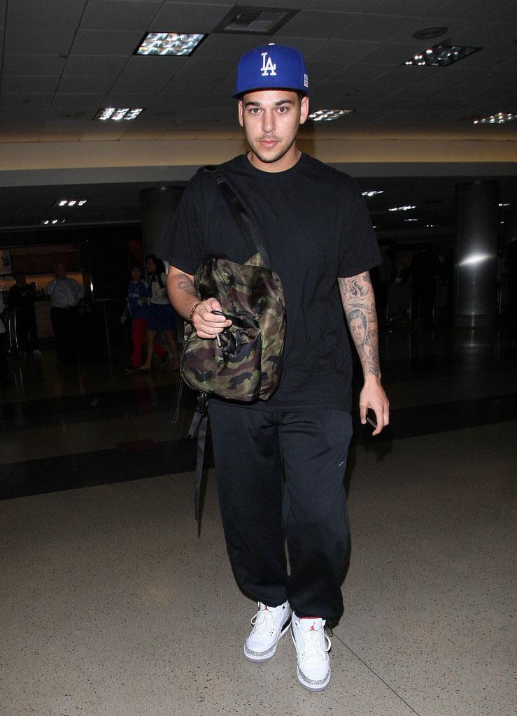c45fb86666030e ... Rob Kardashian at the airport wearing the  DJ Khaled wearing Air Jordan  3 III Retro Black ...