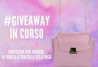Logo Concorso gratuito: vinci gratis una borsa a tracolla Osla rosa