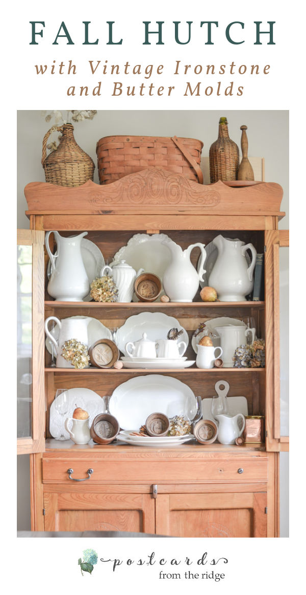 vintage white ironstone pitchers and platters, wooden butter molds, dried hydrangeas in an antique oak hutch