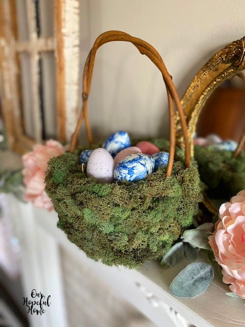 Easter basket moss mantel eggs flowers