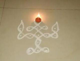 diya rangoli design with dots