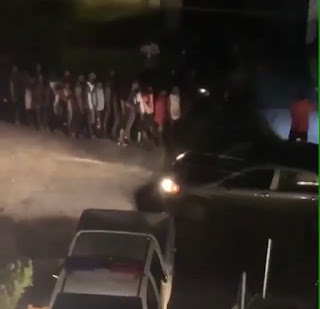 Crowd begging money at davido's house