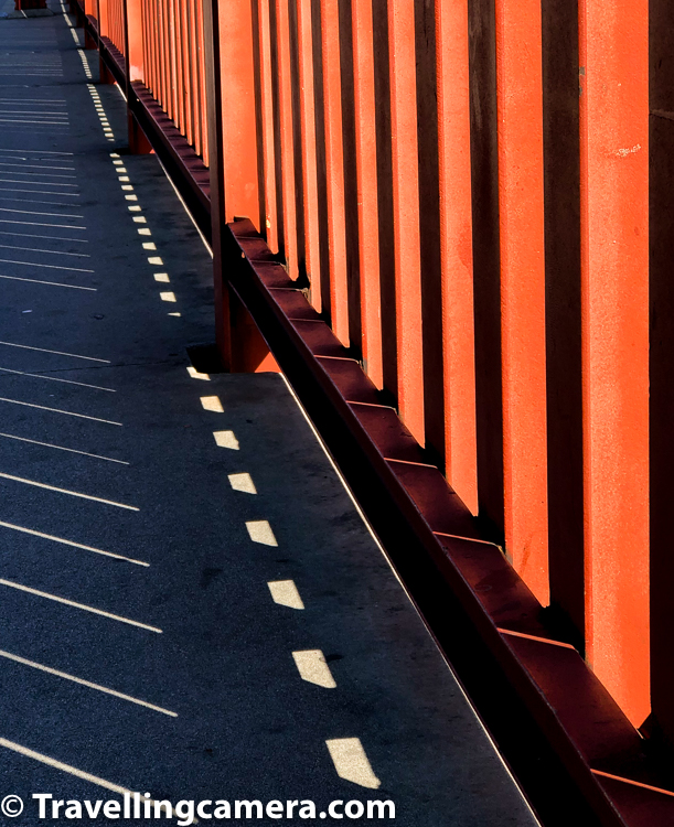 While walking on Golden Gate Bridge, we touched some of the parts made up of iron and one can feel vibration in the bridge due to hundreds of vehicles crossing through it at any point of time. Above photograph shows shadows on the bridge. This is clicked on the side-path where tourists can walk comfortably on the bridge to appreciate this huge bridge along with action happening around the bay - ferries, kayaks, birds, waves, cyclists etc.