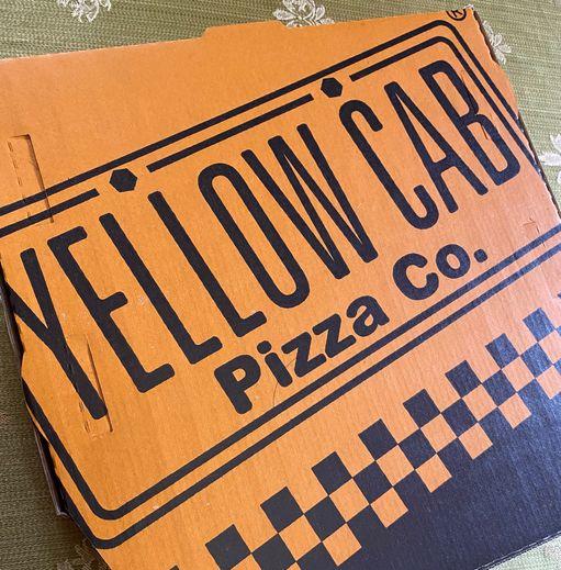 A box of Yellow Cab Chicken Alfredo Pizza