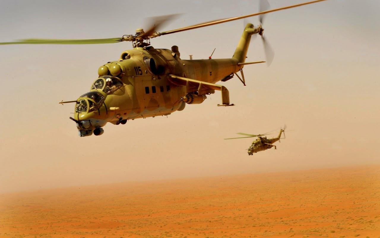 Mil Mi-24 sobrevoa o deserto