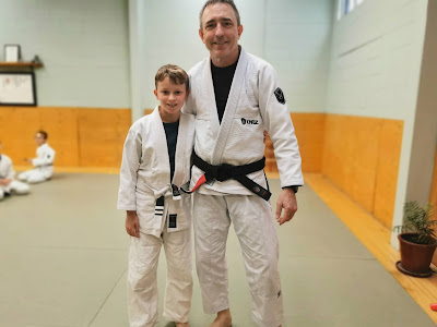 Tommy getting a stripe with Professor Adam Evans