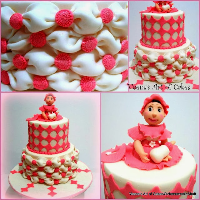 A decorated cake with a baby topper.