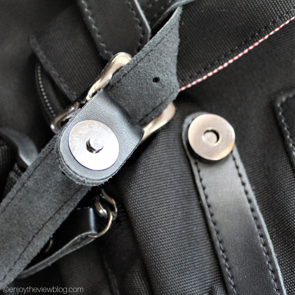 Close-up of the snap closures on the backpack straps