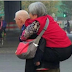 Elderly Man Giving His Wife A Piggyback Ride Across A Busy Street Will Make You Cry