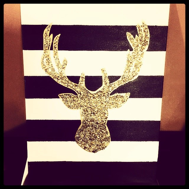 deer silhouette on black and white striped canvas