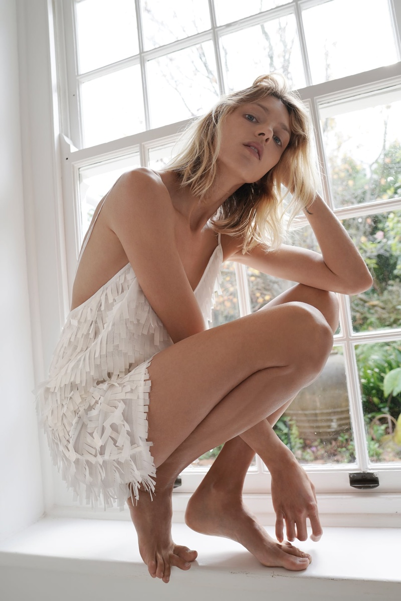 Model Anja Rubik poses in Zara sparkly fringed dress.