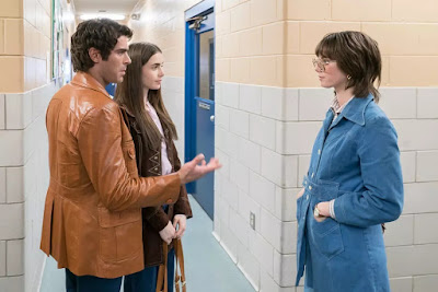 "Movie still for Joe Berlinger's 2019 Netflix film ""Extremely Wicked, Shockingly Evil and Vile"" where Zac Efron's character Ted Bundy, Kaya Scodelario's character Carole Ann Boone, and Lily Collins's character Liz Kendall meet each other at a dog pound for the first time in the 1970's"