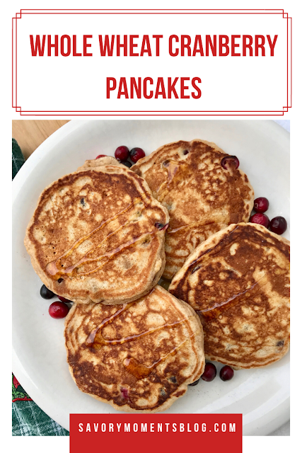 Fluffy and hearty whole wheat pancakes are studded with tart fresh cranberries for a delicious fall or winter breakfast!