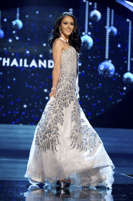 8674431d47bd Miss Thailand Nutpimon Farida Waller: Miss Universe Thailand looked  beautiful in this iridescent white and silver sequined strapless  fit-to-flare gown.