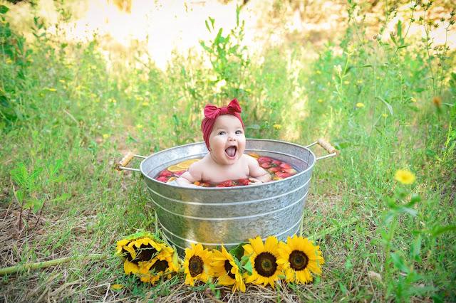 little girl in fruit bath