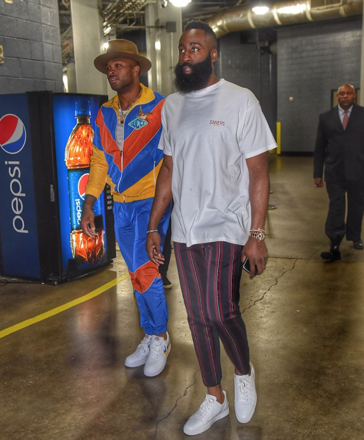 P. J. Tucker and James Harden walk into Houston Toyota Center during playoffs game against Utah Jazz.