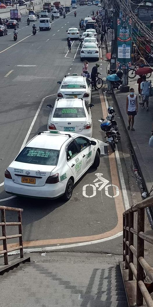 taxi cars parked on bike lanes