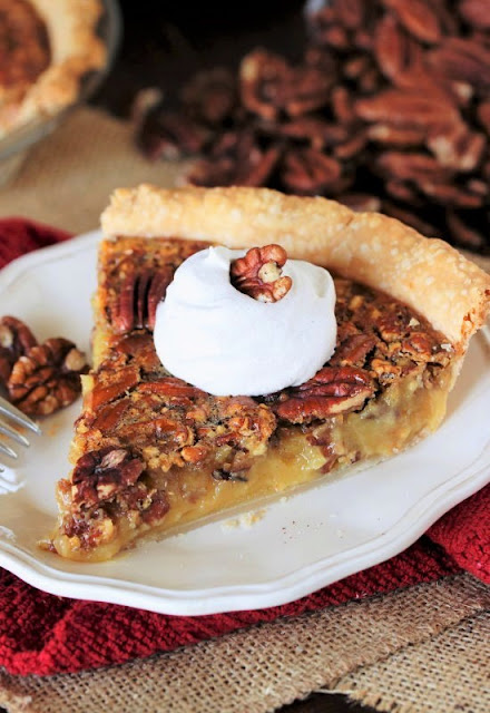 Slice of Pecan Pie Topped with Whipped Cream Image