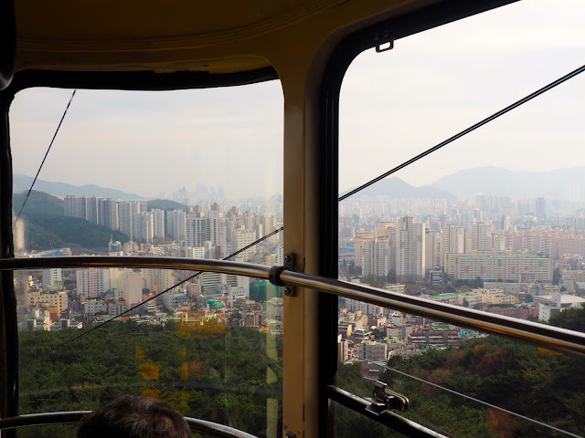 Views of Busan from inside Geumgang cable car, up Geumjeongsan Mountain, Busan, South Korea