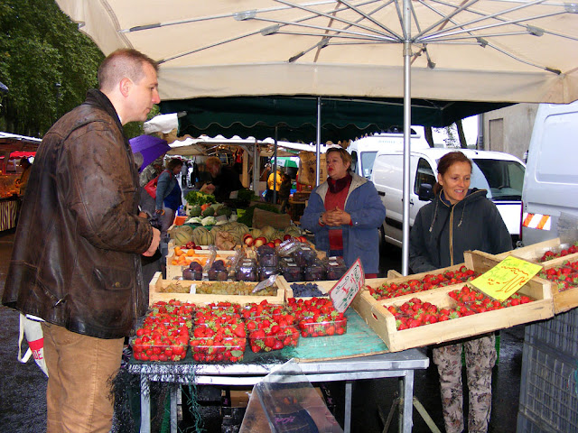 Chef buying strawberries at a regional market, Indre et Loire, France. Photo by Loire Valley Time Travel.