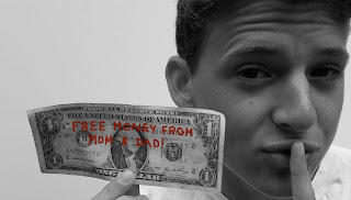 Teen holding free Roth money from Mom and Dad.
