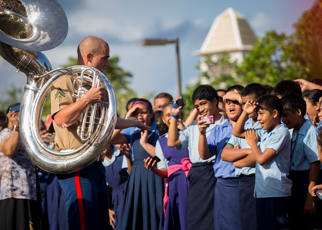 Cpl. Steven Mowen speaks to students during a concert in American Samoa.