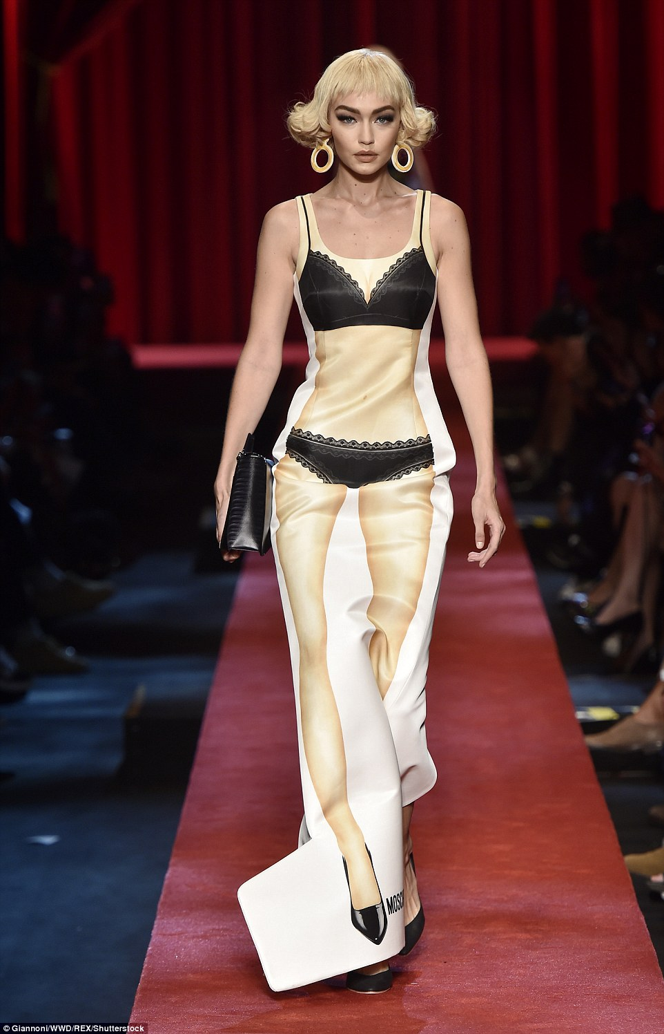 Gigi Hadid turns lingerie clad paper doll for Moschino