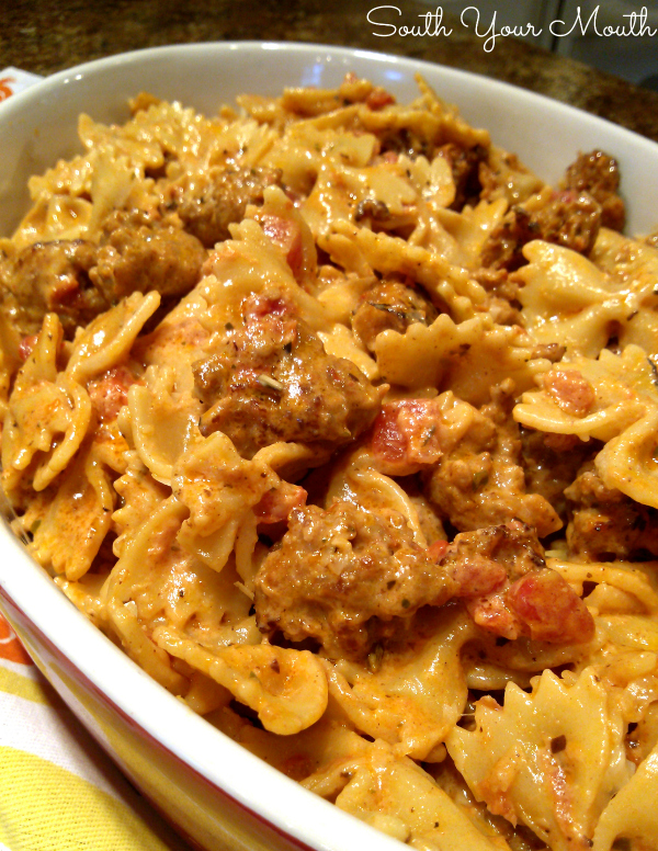 Creamy Italian Sausage Pasta Toss | A quick and easy creamy pasta recipe with Italian sausage, cream, tomatoes and parmesan cheese.