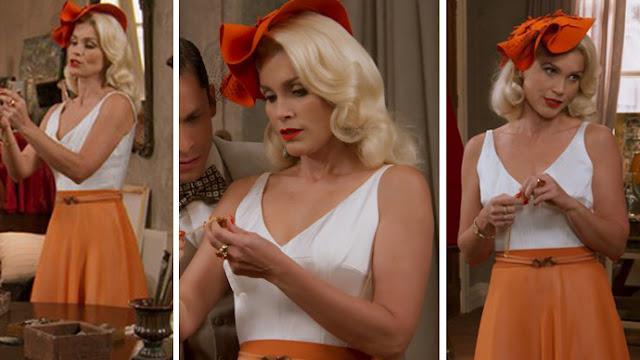 Sandra (Flavia Alessandra), Eta mundo bom, figurino vestido laranja