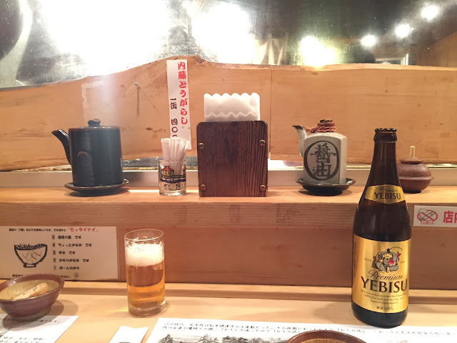 a photo beers on a counter at suzushin, the best tonkatsu in tokyo