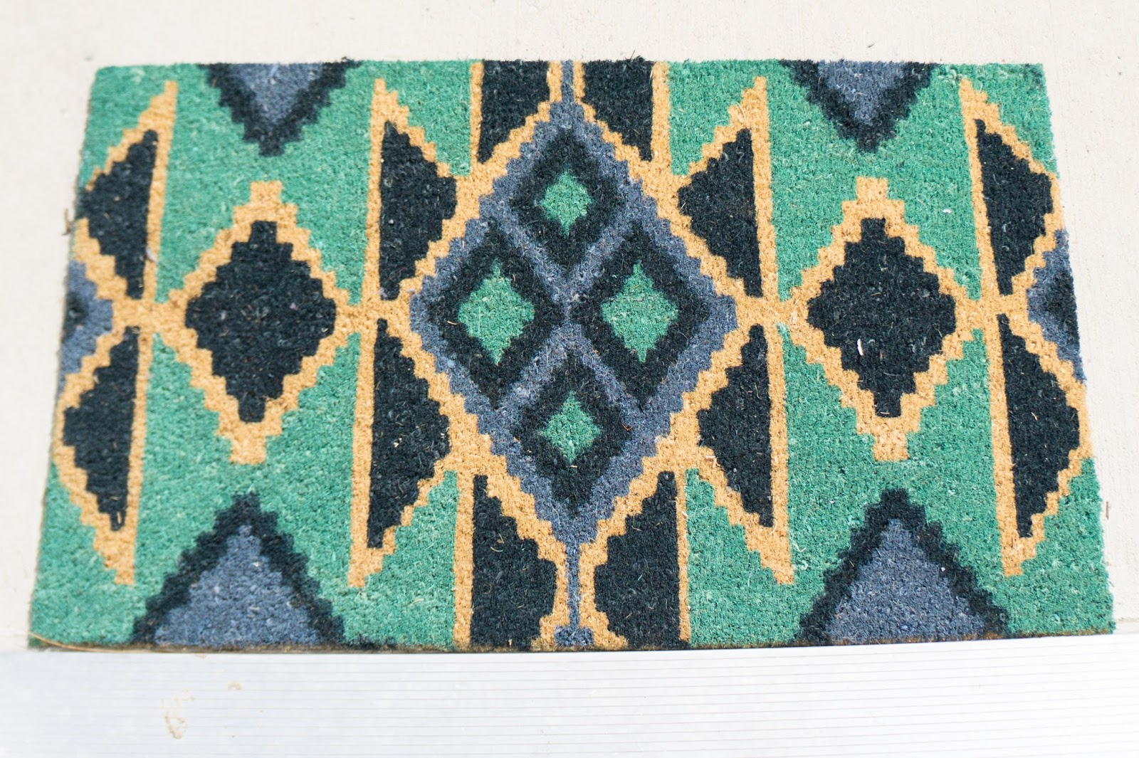Fun, bright, and colorful aztec design welcome mat.