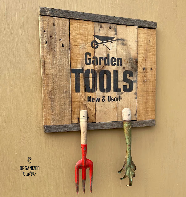 Photo of a pallet sign stenciled with a garden tools stencil