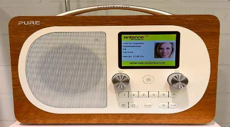 Which company launched the first digital radio broadcast?