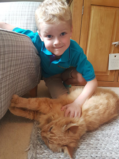 Oliver Guy aged seven with cat