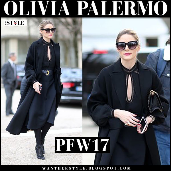 Olivia Palermo in black coat, black belted dress and black ankle booties what she wore paris fashion week 2017