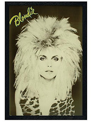Debbie Harry adopting wild hair and animal print in 1983