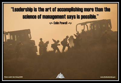 """Leadership is the art of accomplishing more than the science of management says is possible."" - Colin Powell [wildland firefighters and dozers in the smoke]"