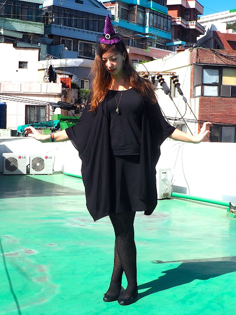 Witch Halloween Outfit   black t-shirt, skirt, ballet shoes and wide sleeved cardigan, spider web tights, and purple witch hat headband