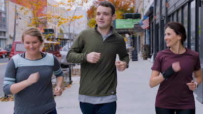 "Jillian Bell, Micah Stock, and Michaela Watkins jog together in New York in a movie still for ""Brittany Runs a Marathon"" (2019)"