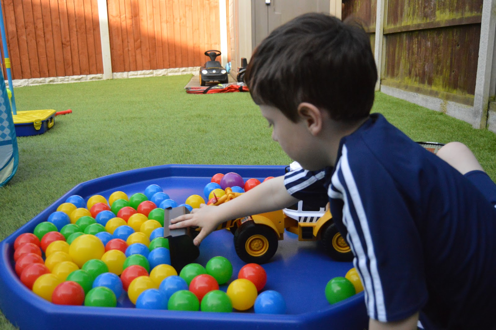 boy playing in a ball pond