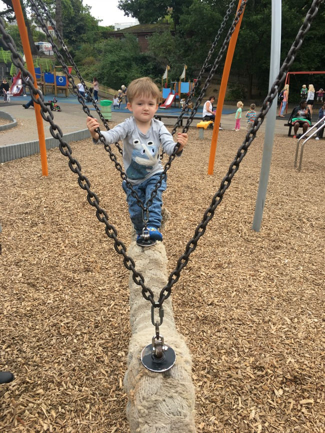boy-standing-on-snake-swing-at-oath-park
