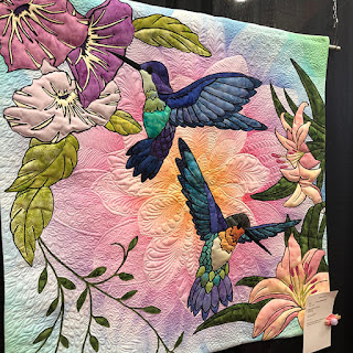 """Hummingbird quilt on """"Dream Big"""" panel. Quilt by Nick Williams"""