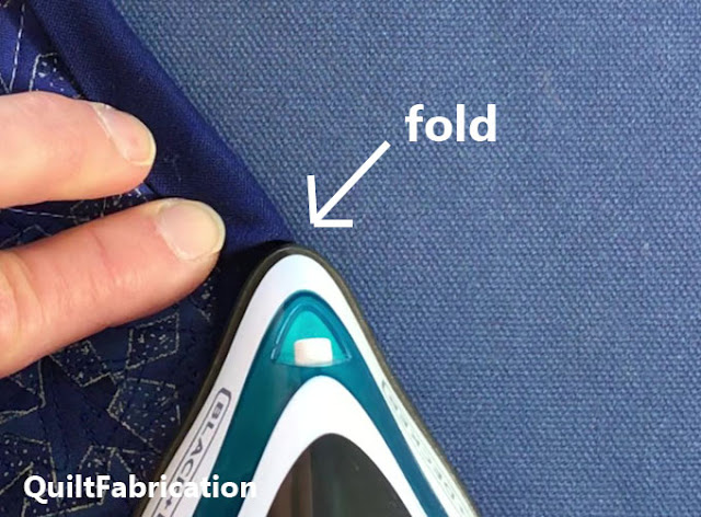 pressing a fold using the iron tip