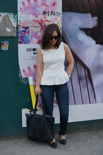 White peplum top with skinny jeans and flats