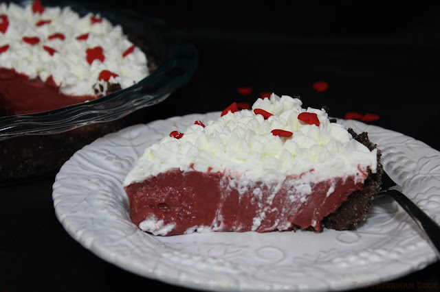 chocolate, red coloring, graham cracker crust, whipped cream topping