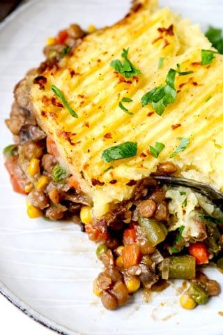 The winter-chill beating comfort food goodness of a classic Shepherd's Pie, minus the meat. This Vegan Shepherd's Pie Recipe features a savory vegetable, lentil and gravy loaded interior, topped with pillowy mashed potatoes, baked in